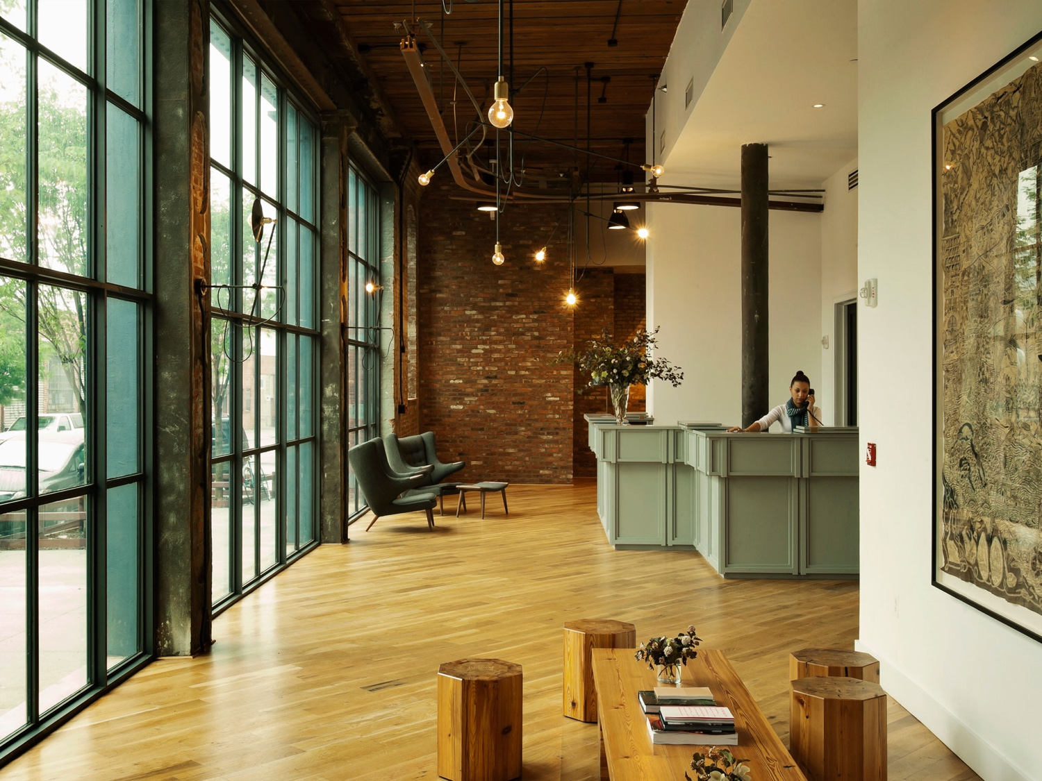 The Wythe Hotel in Brooklyn's hip Williamsburg neighbourhood synthesises a number of smart industrial characteristics, from exposed brick to brilliant lighting and grey steel.