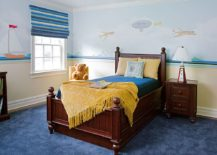 Yellow accents add brightness to kids' bedroom in blue