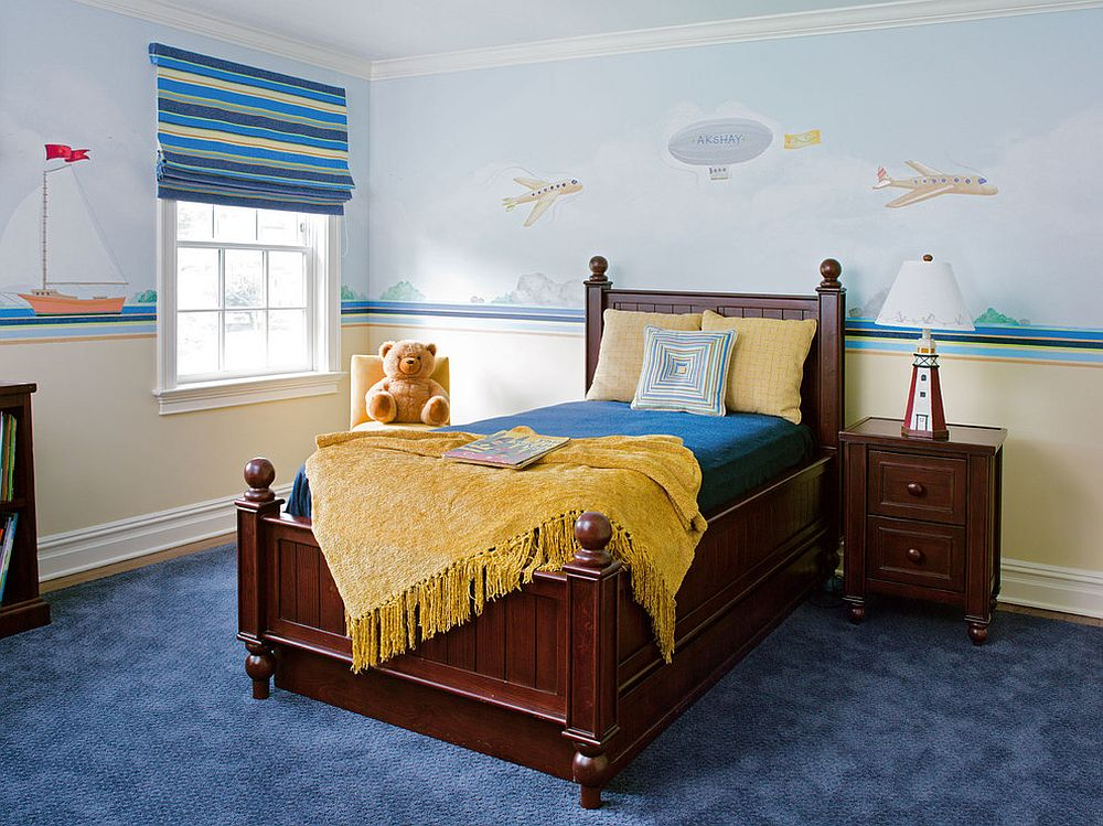 Yellow accents add brightness to kids' bedroom in blue [Design: Robin McGarry Interior Design]