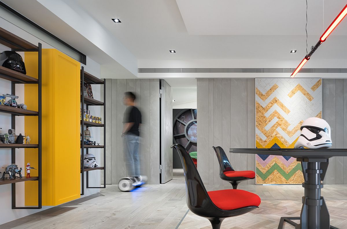 Yellow provides the perfect balance to black in the fun living room