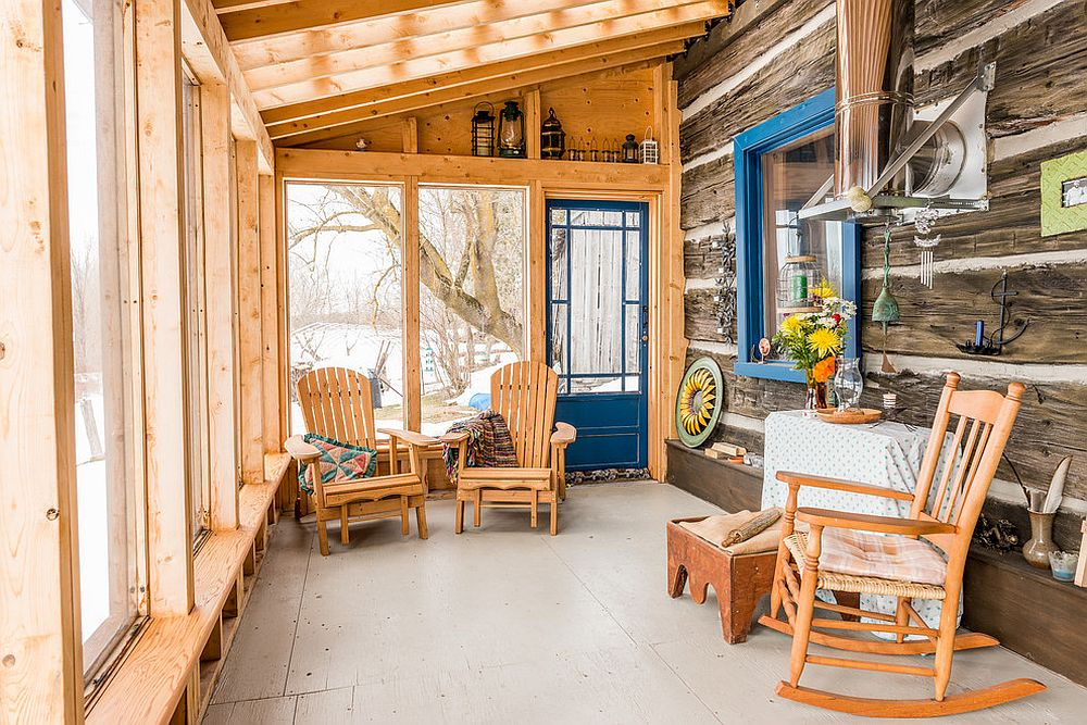 A dash of blue enlivens the cool and modest rustic sunroom draped in wood [Design: Bespoke Carpentry & Joinery]