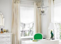 A splash of green enlivens the cool home office in white