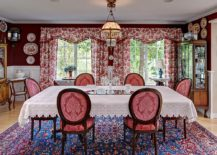 Antique rug, floral drapes and beautiful red walls bring the Victorian dining room alive