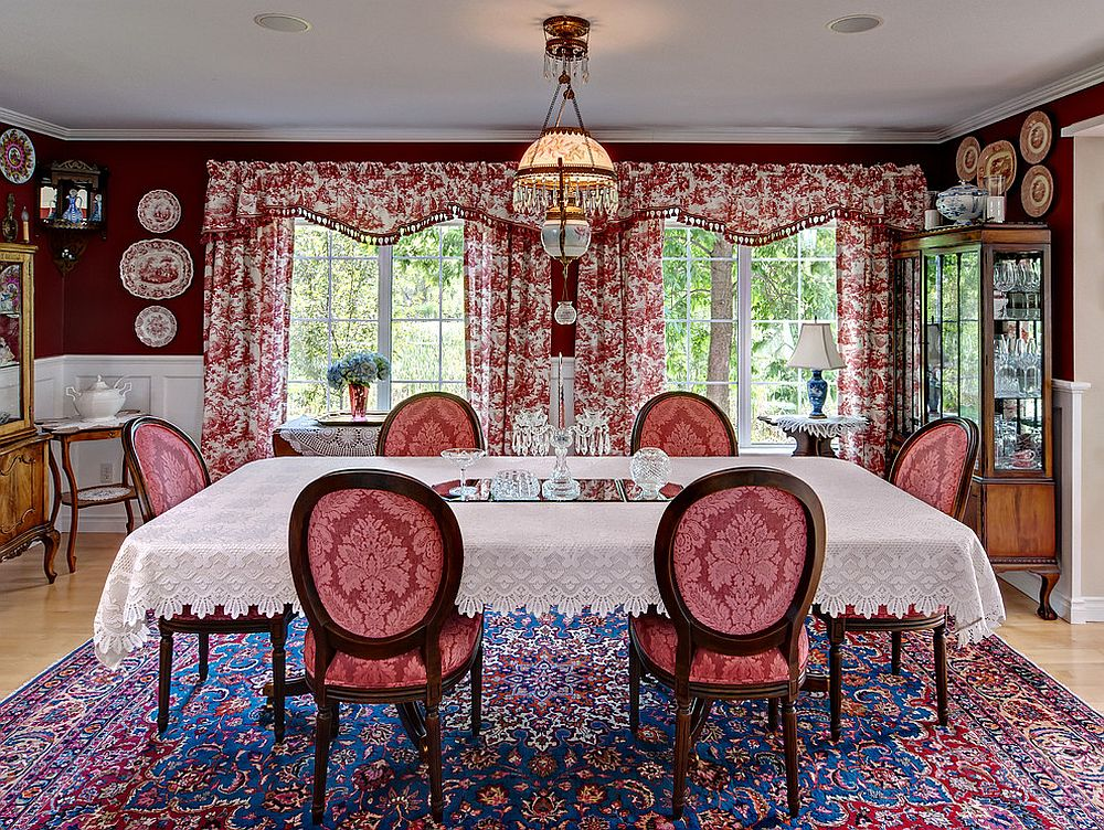 Antique rug, floral drapes and beautiful red walls bring the Victorian dining room alive [Design: Ravnik & Co]