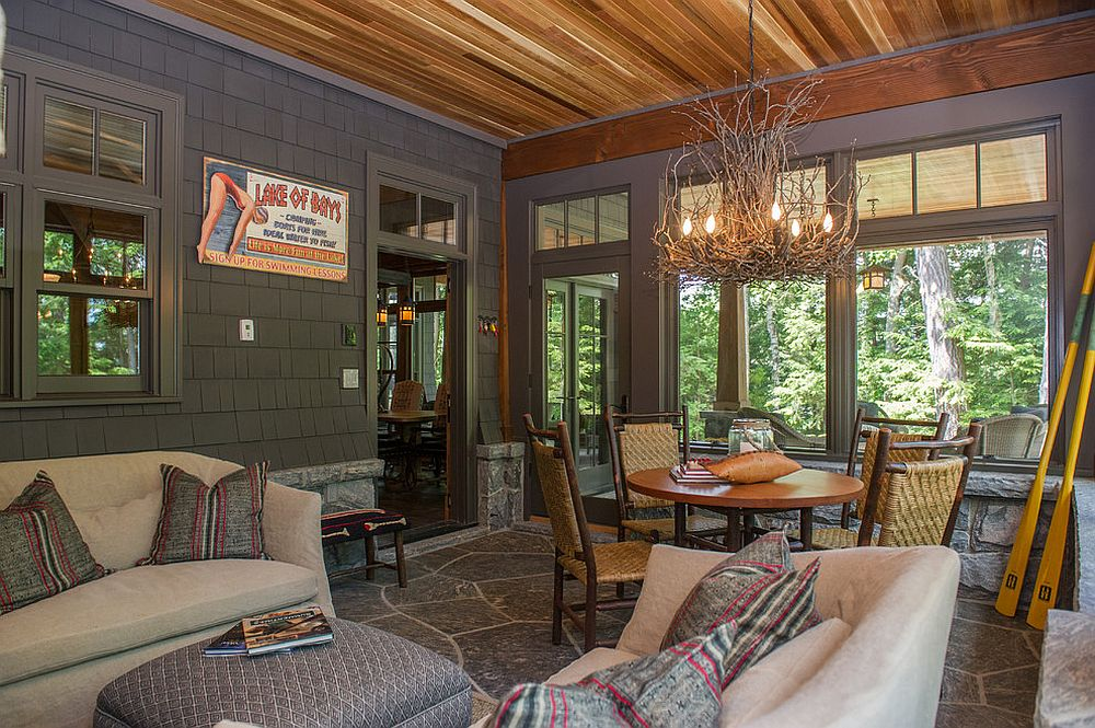 Appalachian Branch Chandelier steals the show in this rustic sunroom [Design: SML Contracting]
