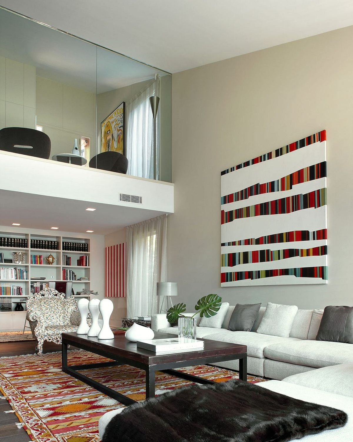Art work, Bookshelf and rug bring color to the open living space