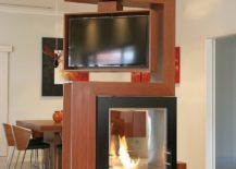 Awesome room divider holds turnable TV and fireplace