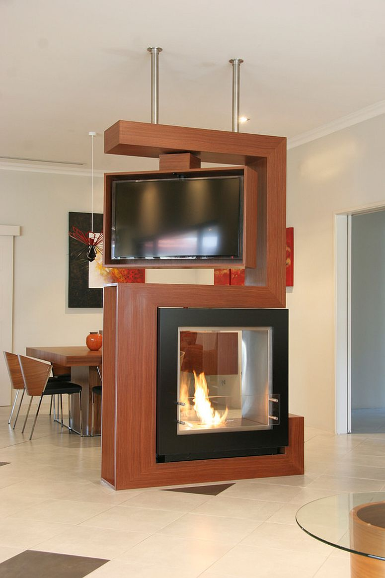 Awesome room divider holds turn-able TV and two-sided fireplace [Design: Despina Design]