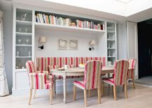 Banquette seating for the Snadinavian dining space with smart shelves all around and colorful chairs 217x155 Refined Simplicity: 20 Banquette Ideas for Your Scandinavian Dining Space