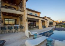 Barbeque zone, deck and pool area of the contemporary Austin home