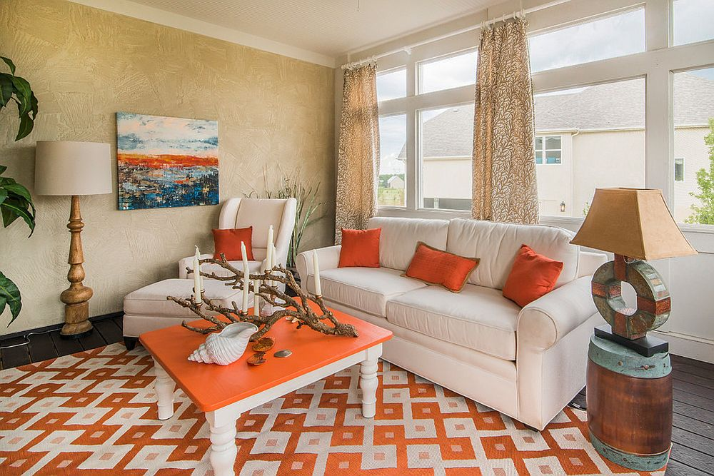 Beachy tropical style sunroom in orange [Design: Nth Degree Home]