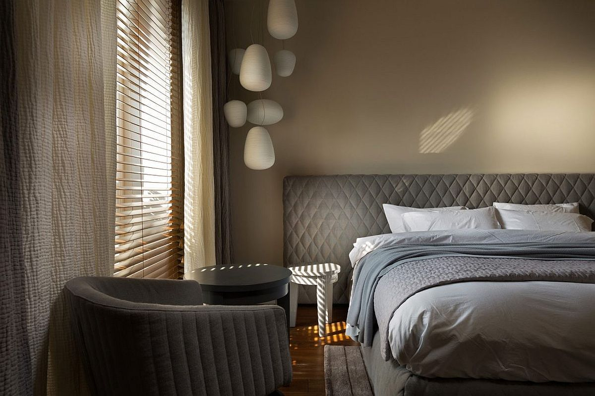 Bedside lighting saves space even as it adds to the feminine vibe of the room