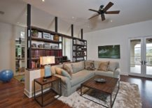 Bookshelf-room-divider-with-half-wall-offers-ample-display-space-217x155