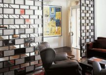 Bronze plates, glass and mirrors shape a stunning room divider