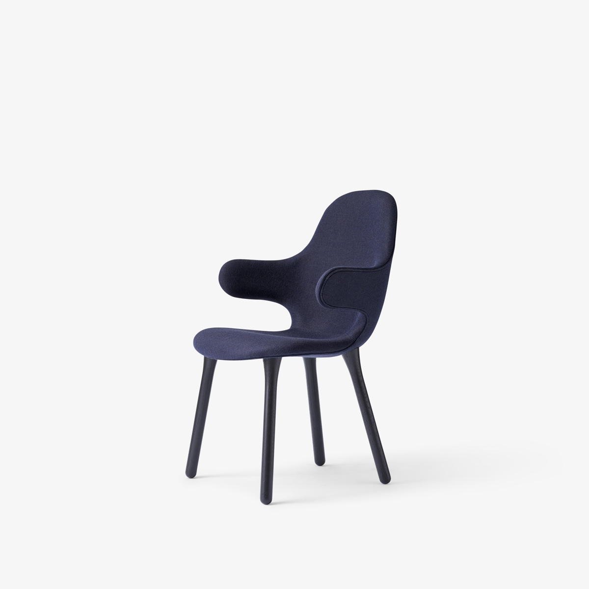 The Catch Chair by Jaime Hayon for &Tradition welcomes the sitter with outstretched and open arms, flaunting Hayon's distinctively playful approach to design. The Catch Chair is pictured in dark blue. Image courtesy of &tradition.