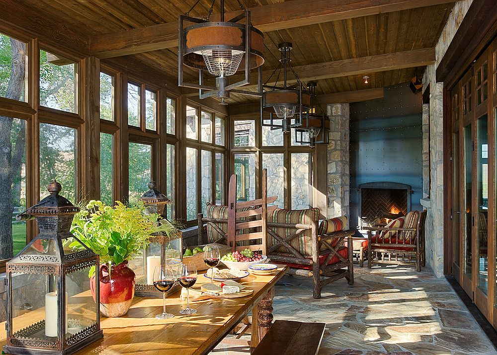 Classic rustic ranch style for the spacious sunroom with dining area [Design: Mibroc Group]