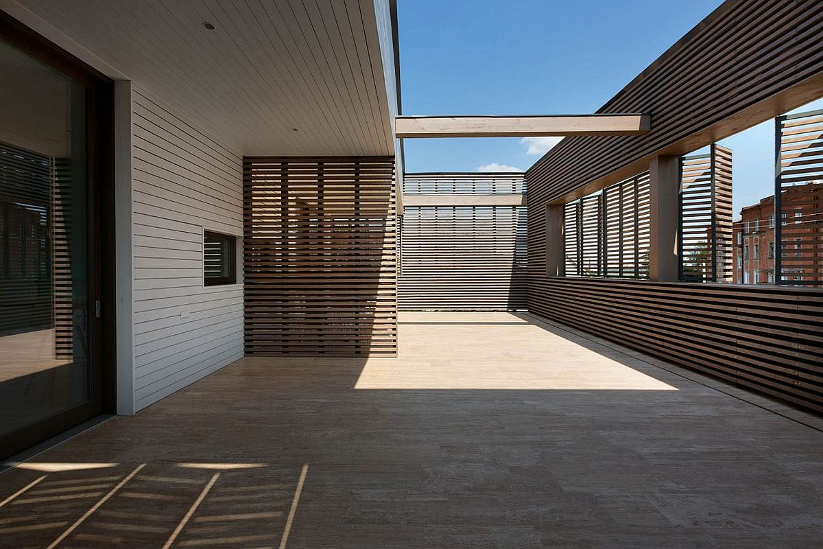 Semi open deck and terrace promote outdoor living at ark for Semi open spaces