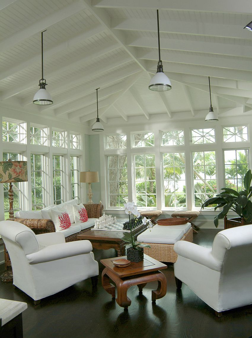 Coastal and tropical styles combined elegantly in the sunroom [From: Rob Downey Photography]