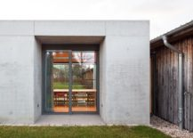 glass and concrete pavilion extends timber paneled home in leipzig. Black Bedroom Furniture Sets. Home Design Ideas