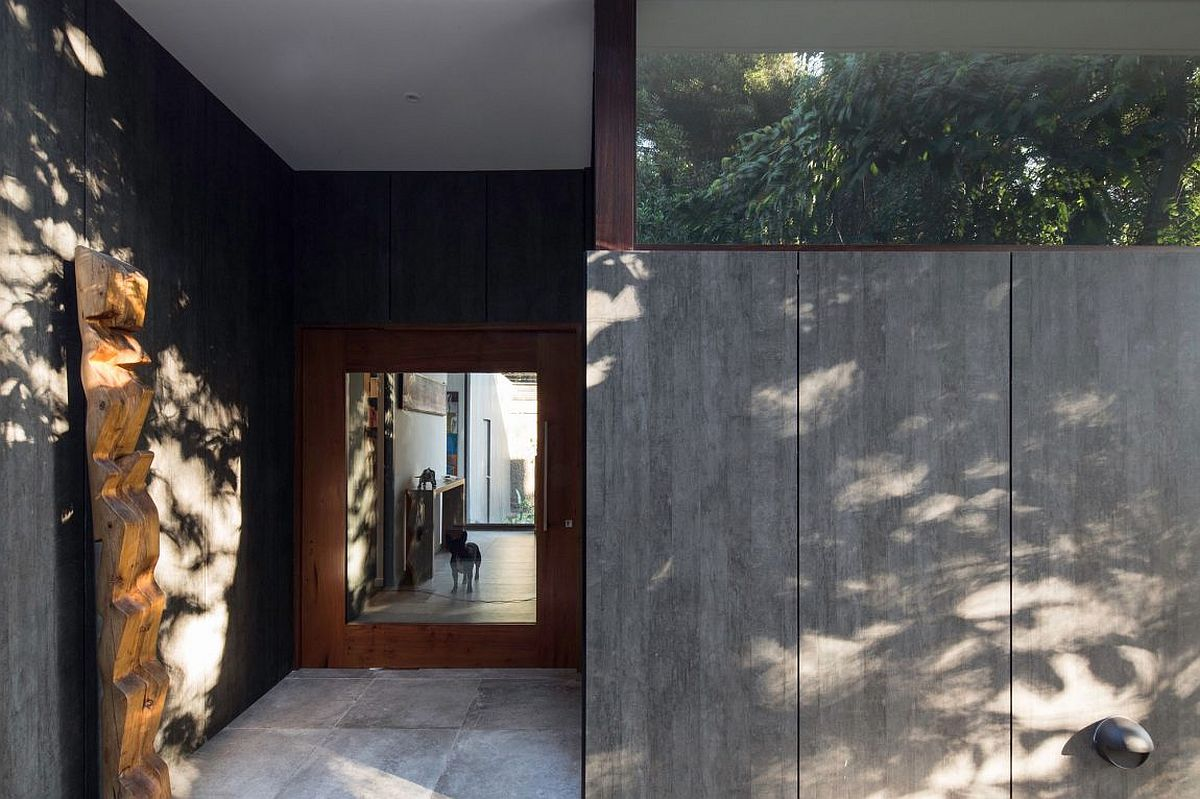 Concrete and metal shape the entrance of the distinct home