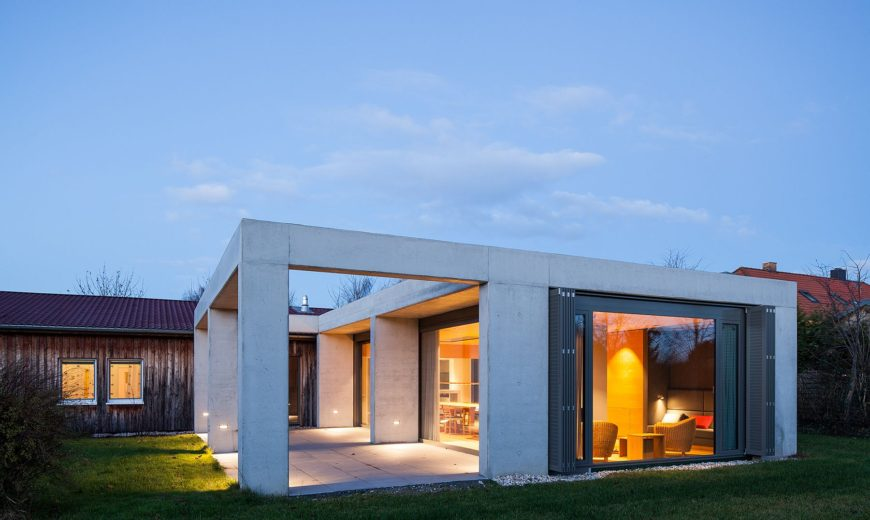 Glass and Concrete Pavilion Extends Timber-Paneled Home in Leipzig