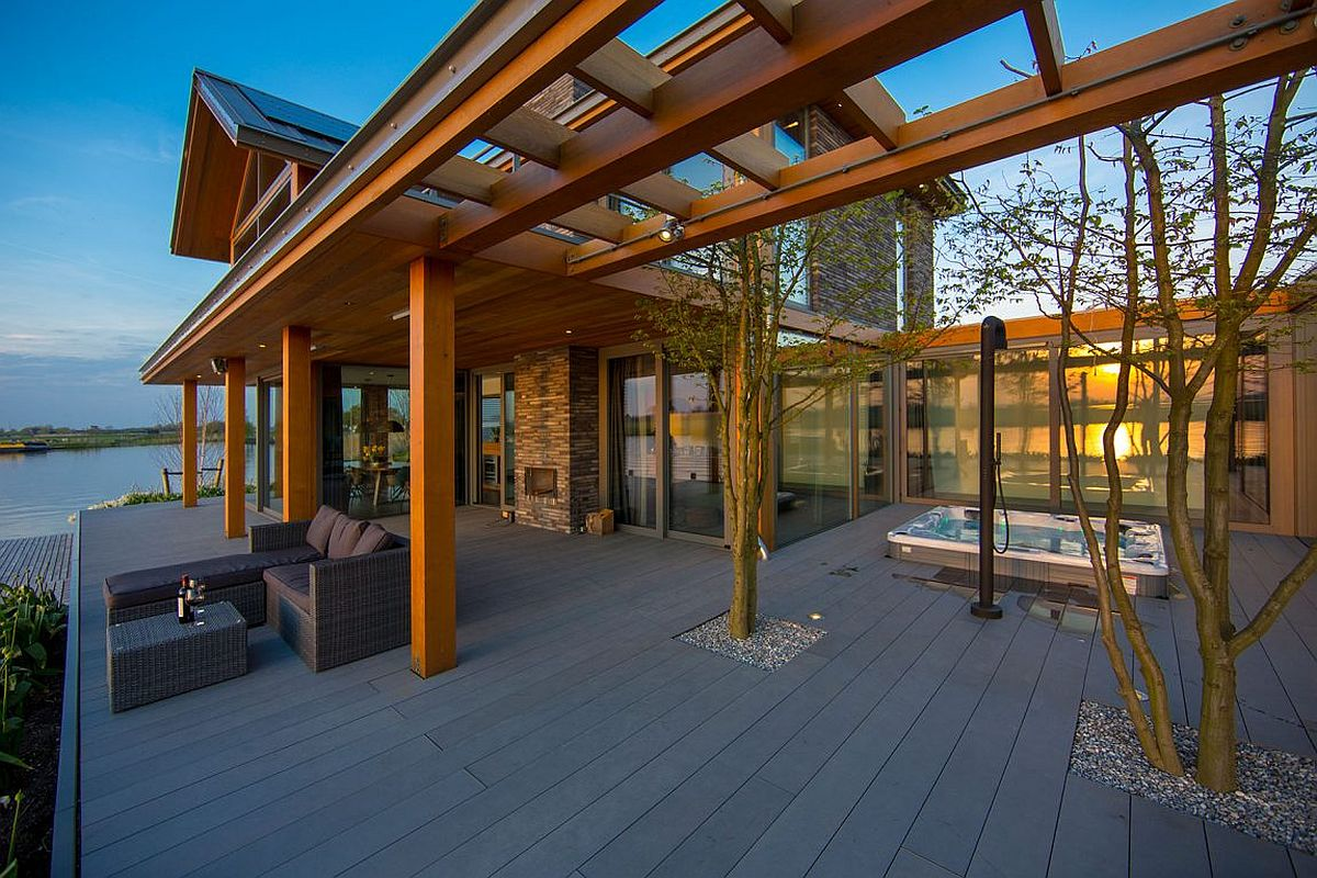 Contemporary deck with hot tub and a simple outdoor living space