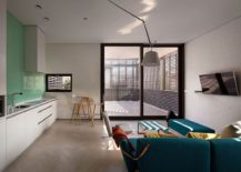 Contemporary living room and kitchen with splash of blue and green