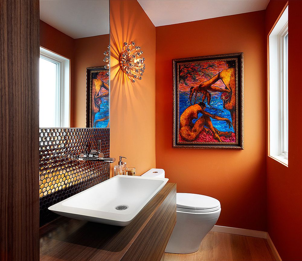 Contemporary powder room in bright orange with dazzling backsplash for sink [From: Lisa Petrole Photography]