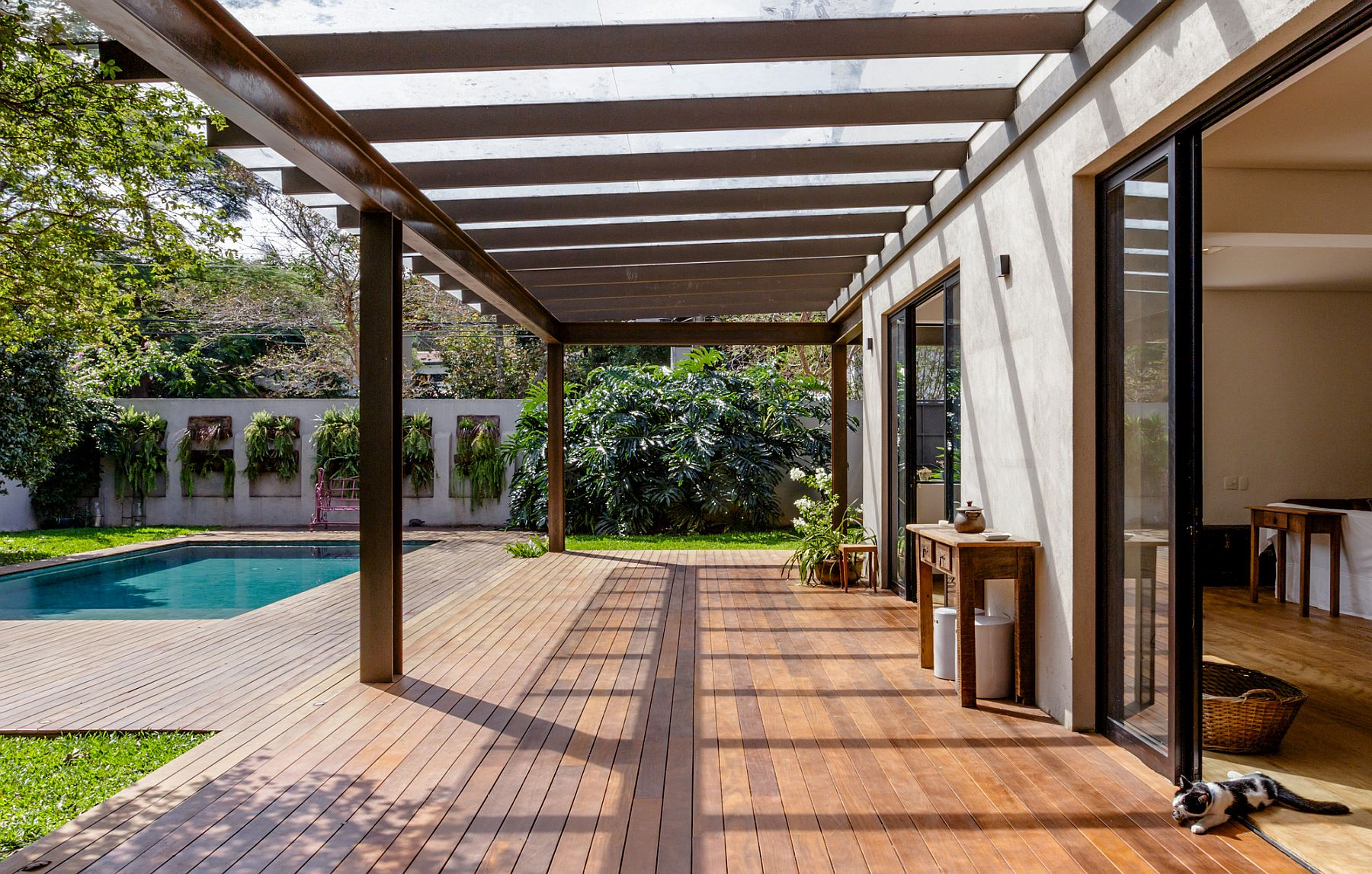 Cor-ten steel structure of the pergola offers shade