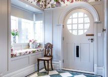 Cottage style coupled with eclectic charm and color in the entry hall