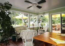 Cozy and elegant sunroom filled with green goodness and a natural vibe