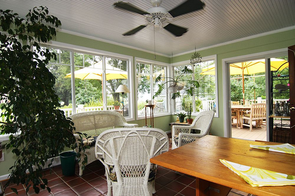 Cozy and elegant sunroom filled with green goodness and a natural vibe [Design: Criner Remodeling]