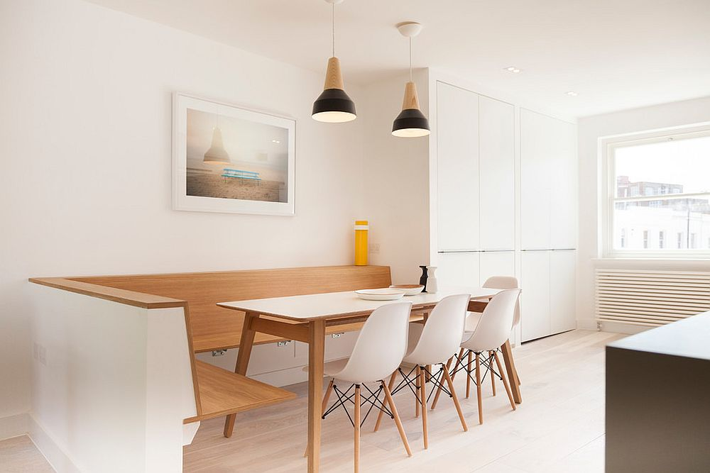 Cozy and minimal kitchen banquette epitomizes the simplicity of Scandinavian style