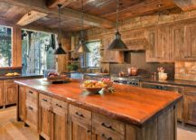 Cozy rustic kitchen filled with reclaimed barn wood