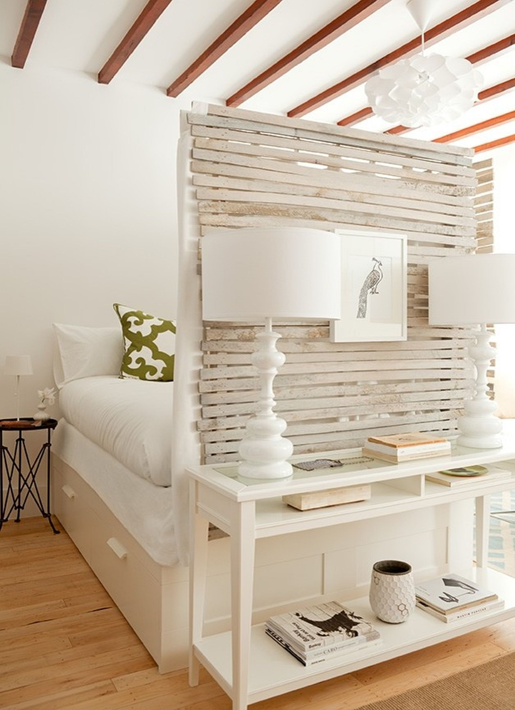 Craft your own room divider by taking the help of foot of your bed!