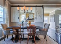 Creating-visual-connection-between-kitchen-and-dining-with-small-window-and-sliding-doors-217x155
