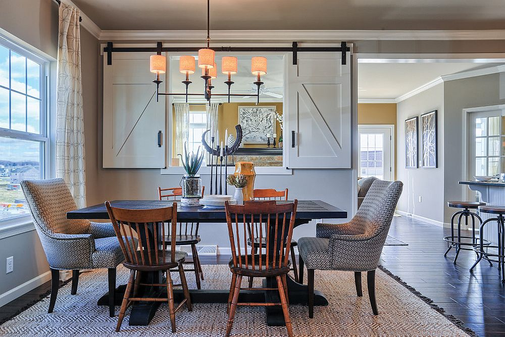Creating visual connection between kitchen and dining with small window and sliding doors [From: Garman Builders / Justin Tearney]
