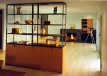 Cupboard-and-bookshelf-unit-offers-storage-and-display-space-even-while-doubling-as-a-room-divider-217x155
