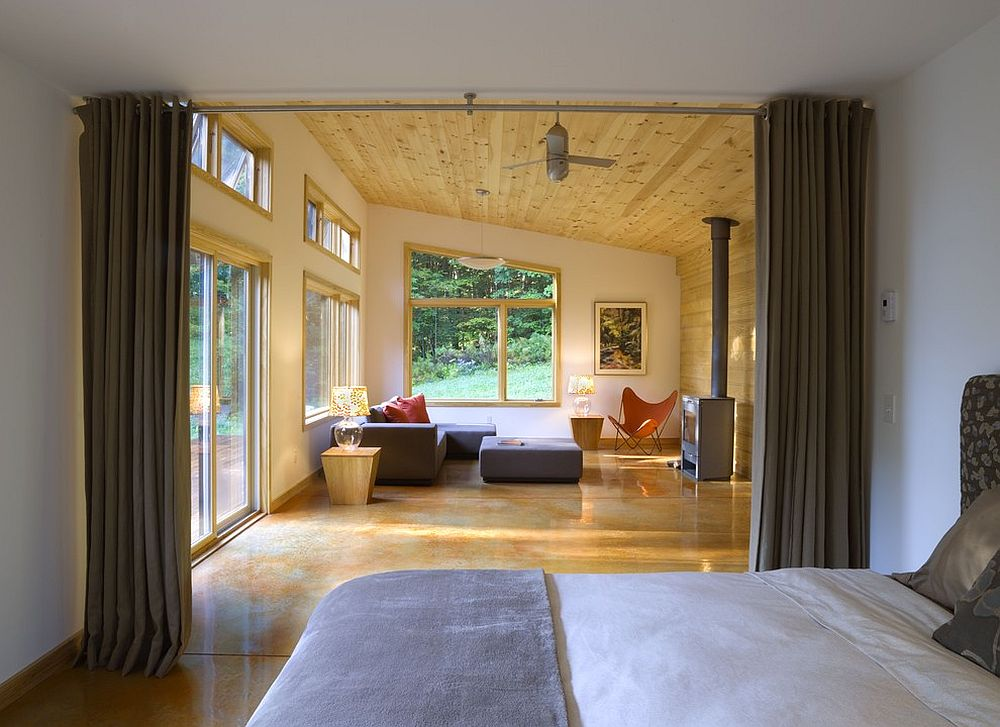 Curtains offer a simple and effective way to separate the bedroom from the living area