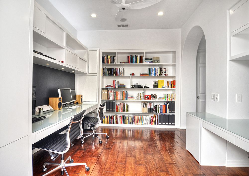 Custom built-in bookshelf brings color to this white home office [Design: m.a.p. interiors inc. / Sylvia Beez]