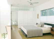 Custom-built-room-divider-also-offers-ample-wardrobe-space-217x155
