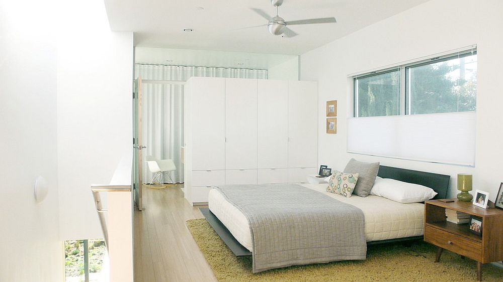 Custom built room divider also offers ample wardrobe space [From: ras-a]