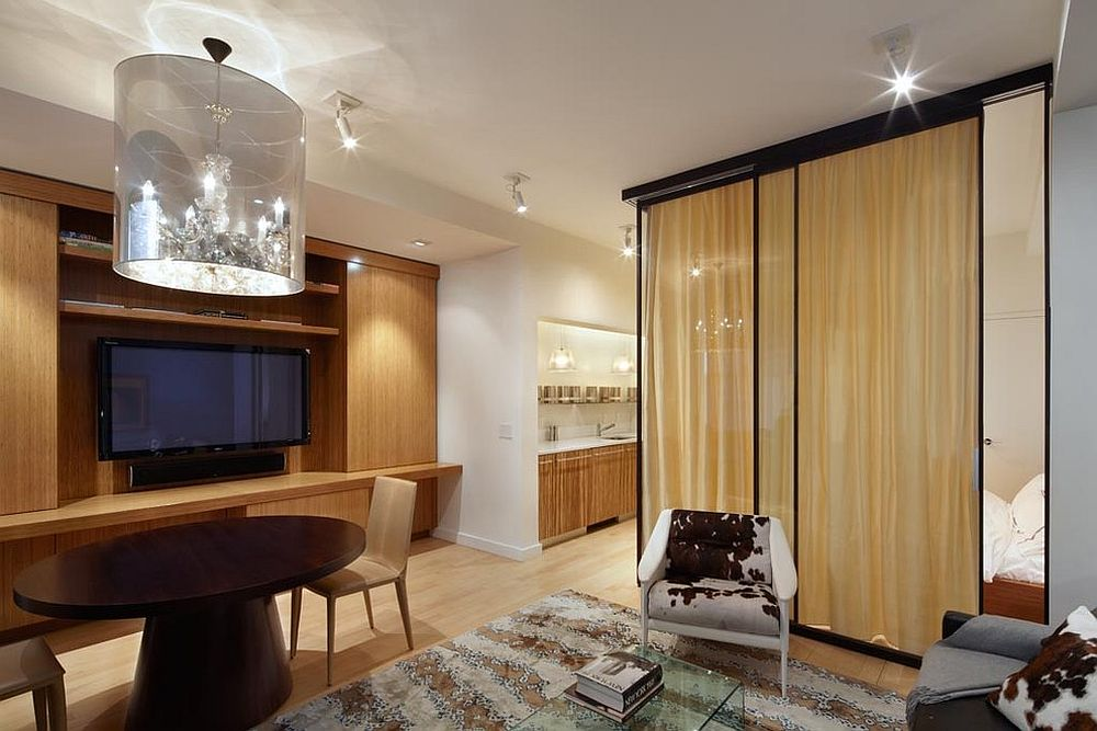 Custom glass wall room divider with drapes encloses the bedroom [Design: Axis Mundi]