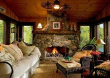 Custom stone fireplace elevates the style quotient of the beautiful rustic sunroom 217x155 Timeless Allure: 30 Cozy and Creative Rustic Sunrooms