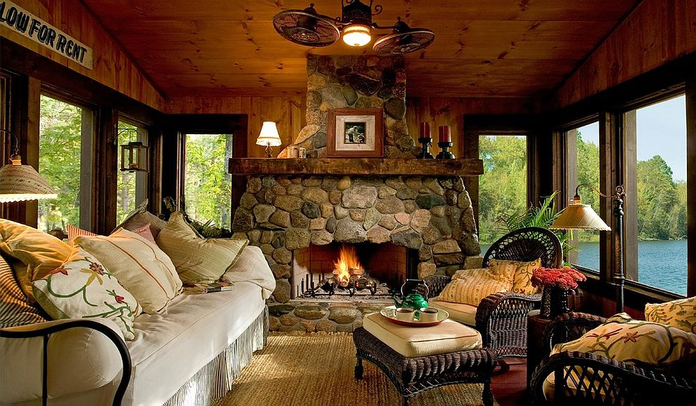 Custom stone fireplace elevates the style quotient of the beautiful rustic sunroom [Design: Lands End Development - Designers & Builders]