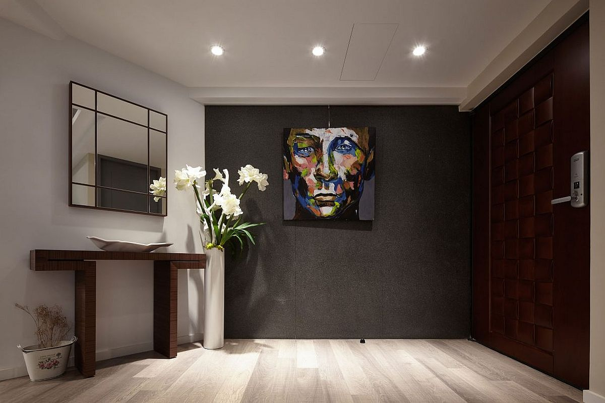 Dark and dashing entry of the renovated apartment in Taipei Dark Sophistication: Thirty Year Old Apartment Embraces a Smart, Modern Sheen