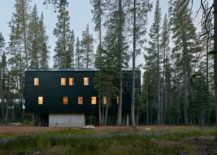 Dark exterior of the cabin allows it to blend in with the landscape after sunset 217x155 Built to Withstand Heavy Snowfall: Dashing Cabin in Sugar Bowl Ski Resort
