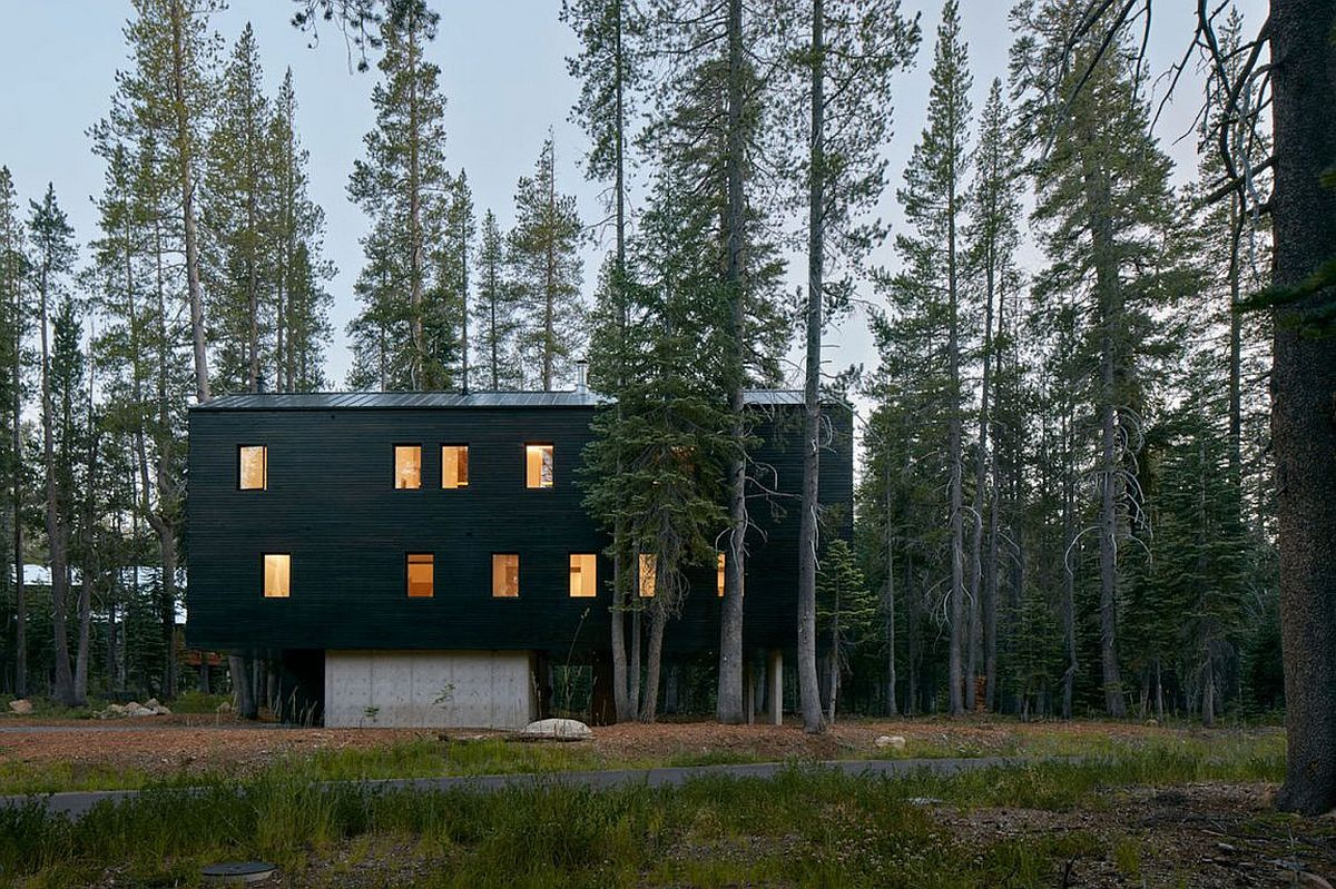 Dark exterior of the cabin allows it to blend in with the landscape after sunset