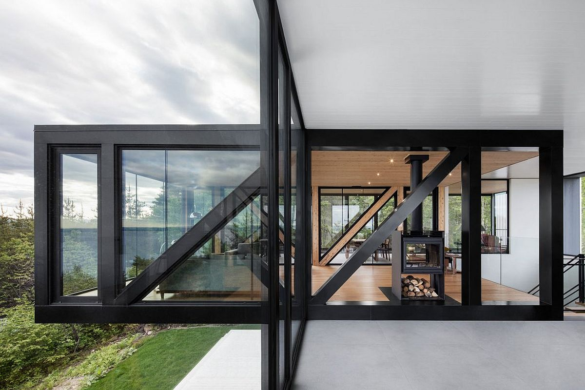 Dark framed glass walls give the elegant chalet its unique modern vibe