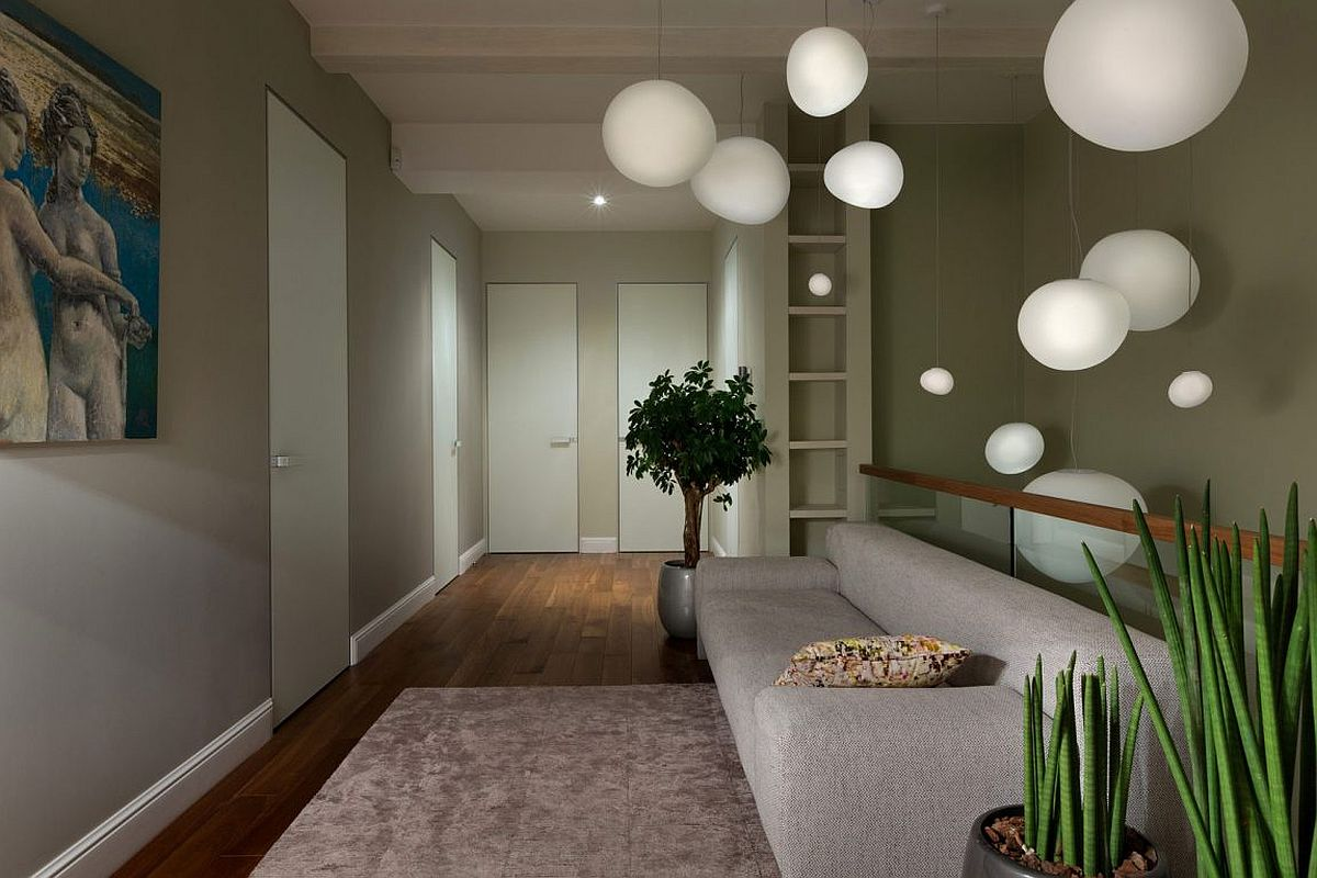 Dazzling pendant lights create a dreamy setting inside the Kiev home